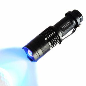 Golfball-Uhu-Shop LED Ballfinder Schwarz Ball angestrahlt für Website